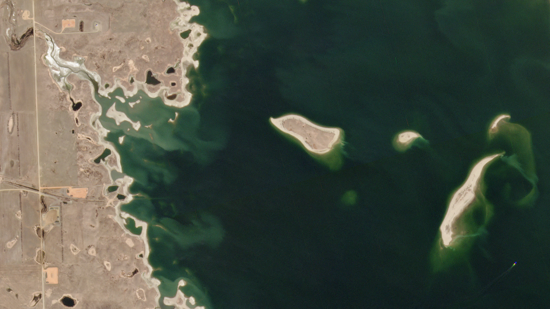 The U.S. Army Corps of Engineers uses PlanetScope data to monitor the habitat of several endangered species along the Missouri River. This pair of images shows the fluctuating shoreline of Lake Sakakawea, North Dakota (one of the river's many reservoirs) on April 22, 2019, and April 22, 2020. Endangered piping plover nest on the ever-shifting sandbars along the water's edge, and Planet's frequent and wide-area imagery helps the Corps ensure that changing lake levels do not damage their habitat. © 2020, Planet Labs Inc. All Rights Reserved.