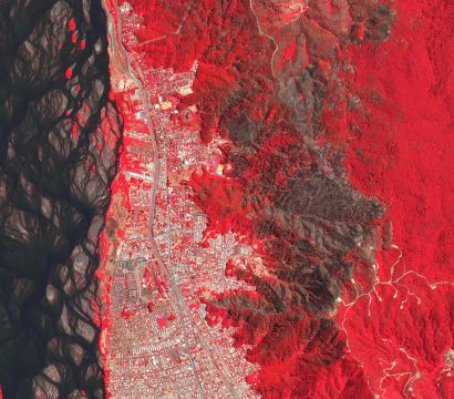 This false-color (near infrared, red, green) image shows a forest fire adjacent to Concepción, Chile in January of 2020. © 2020, Planet Labs Inc. All Rights Reserved
