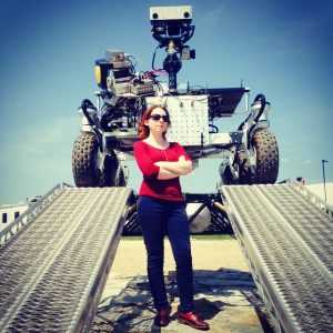 Image of Tanya Harrison with a Mars rover